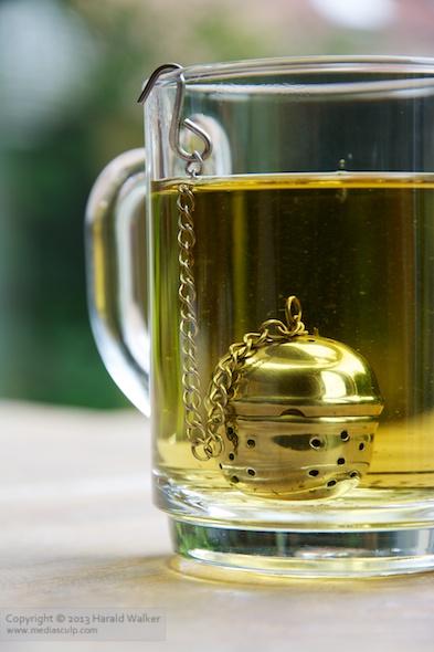 Glass mug with homemade peppermint tea